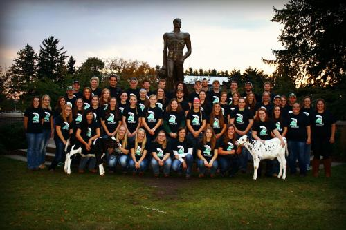 Members of the Dairy Club pose in front of Sparty.