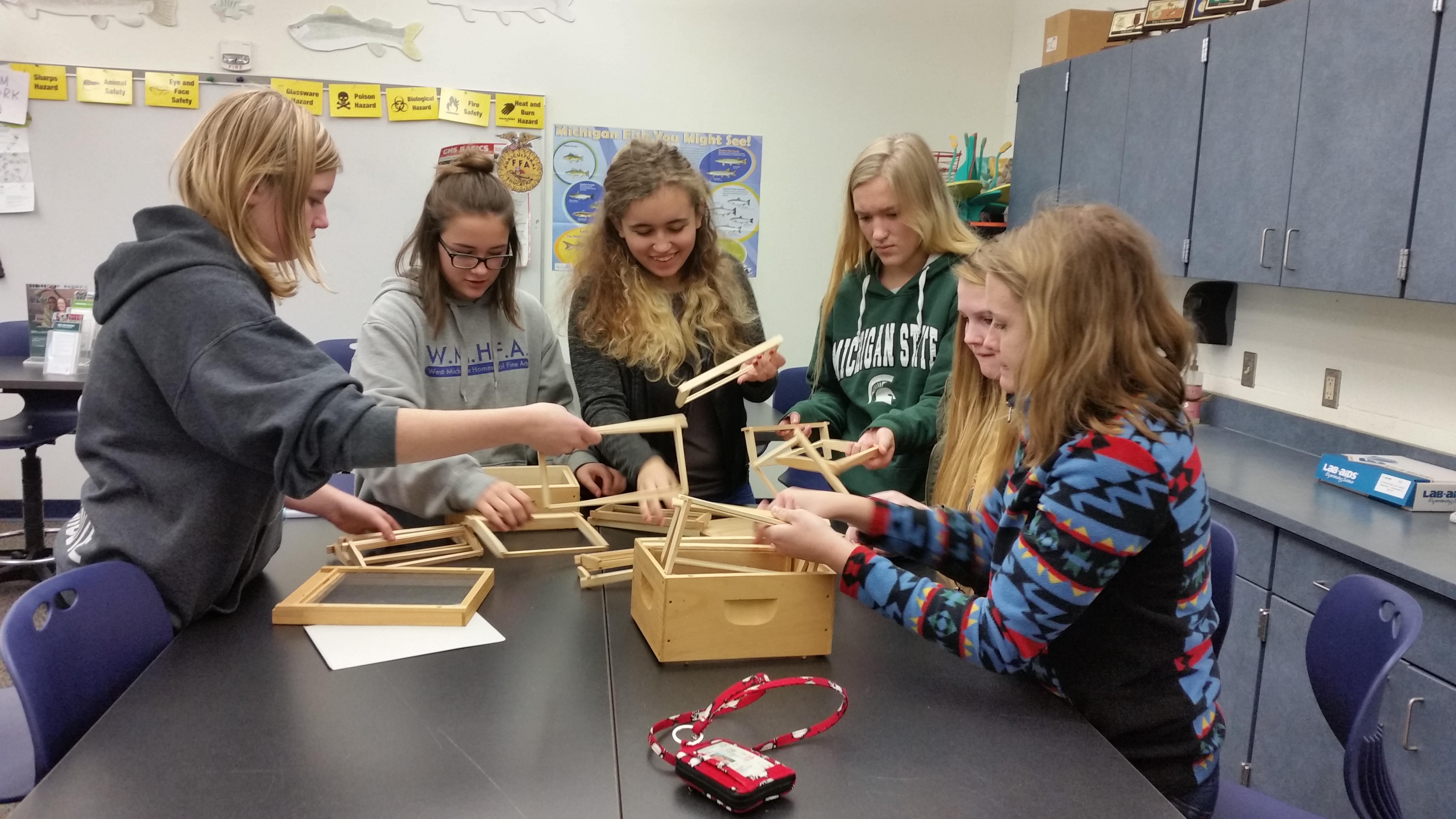 Students assembling model beehives at West Shore Community College