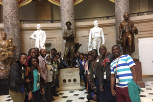 BHEARD students pose near the statue of Norman Borlaug in the U.S. Capitol.