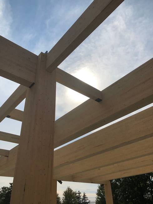 Photo of glulam beams during construction of the mass timber used in the new STEM Teaching and Learning Facility.