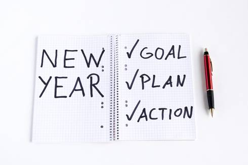 Notepad with New Year written on it