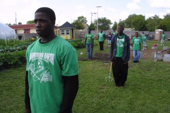 Young people in the field at Harvesting Earth Farm in Flint, Michigan.