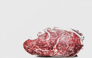 Chunk of meat on gray background.