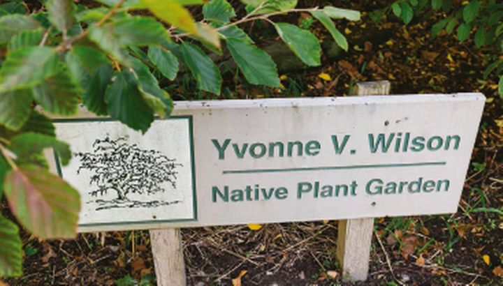 Photo of the sign for the Yvonne V. Wilson Native Plant Garden.