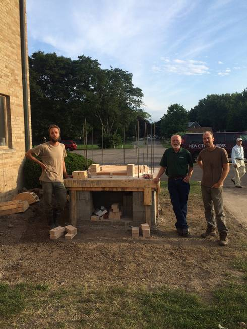 Lance Kraai, Dean Baas and Joel Schraam with the new wood-fired pizza oven kit.