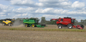 Combines running at the 2012 field day.