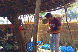 Tim Silberg, CSUS graduate, talking with community members in Malawi.