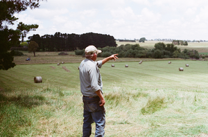 a man pointing out into a field