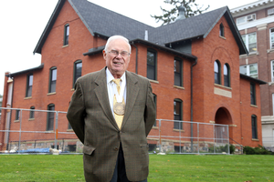 Gary L. Seevers stands in front of Cook Hall.