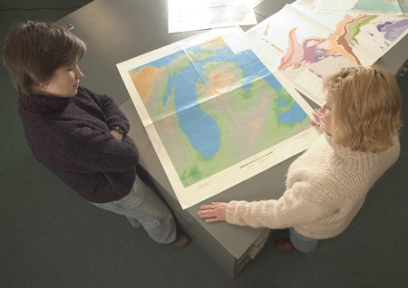 Patricia Soranno (left) and Mary Bremigan examine a map of some of Michigan's freshwater resources