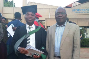 Harrington Nyirenda (left) with his advisor at his graduation ceremony.