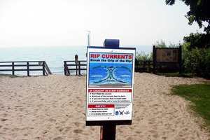 Rip current sign at an Upper Peninsula Great Lakes beach.