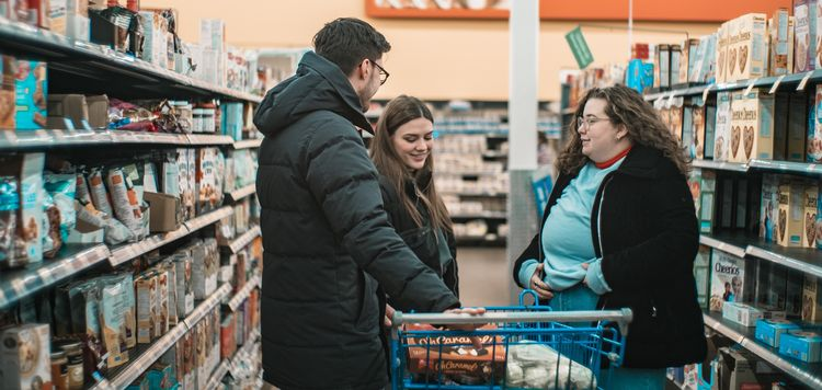 Grocery shoppers chat in an aisle