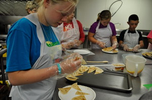 FRIENDS Campers learn about nutrition and food safety while preparing cinnamon tortilla chips.