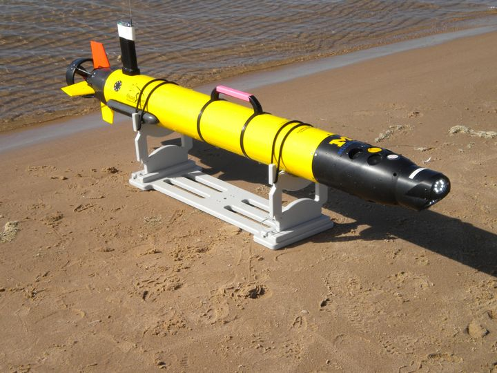 Newly developed technology - the Autonomous Underwater Vehicle (AUV) is used to survey the region between the nearshore sand bars that run parallel to the shore to help approximate rip current locations. Photo courtesy: Michigan Sea Grant