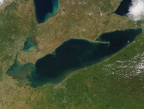Image of Lake Erie from May 16, 2016 taken by MODIS on NASA's Terra satellite. Sediment in the western basin and along the Ohio coast was stirred up due to strong westerly winds. These winds also pushed the Maumee River plume (dark brown) south and east.