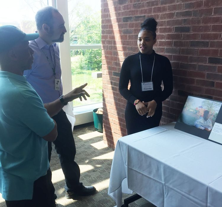 Students from schools in the Southeast Michigan Stewardship (SEMIS) Coalition present their photovoice projects to SEMIS participants and stakeholders at the 2016 Community Forum.
