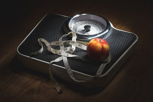 Scale with apple and tape measure