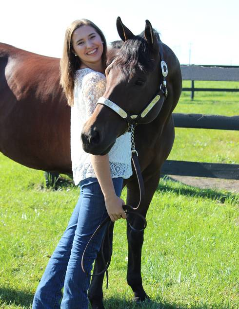 Erin Kramer poses with her horse, Hef. Photo by Diane Kramer.