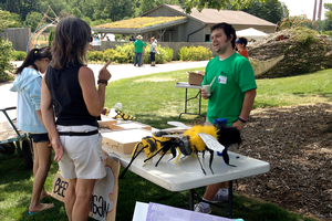 A visitor talks with an expert at last year's Bee Palooza.