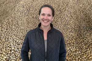 Kendra Levine in front of potatoes, Michigan State University Department of Agricultural, Food, and Resource Economics