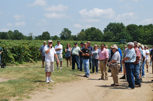 Visitors listen to equipment demonstration at the 2014 Viticulture Field Day in Benton Harbor.