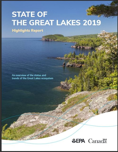 The cover of the new report State of the Great Lakes 2019 shows a picture of a lakeshore taken from atop a high elevation and looking down the shoreline.