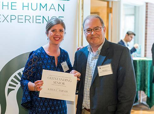 Image of Kayla Turner and URP Professor Mark Wilson with award certificate.
