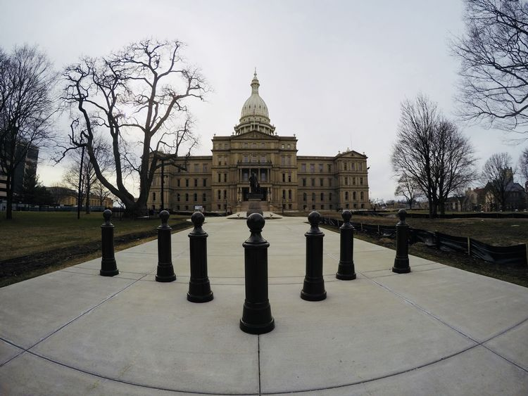 The outside of the Lansing Capital building, view from the sidewalk.