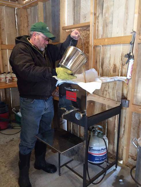 Mike Lucks working in his sugar shack to turn maple sap into syrup!