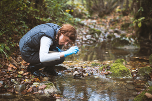Woman testing water quality