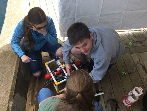 Youth building an underwater remotely operated vehicle