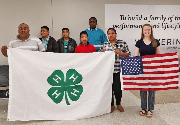 Youth with 4-H and America flags
