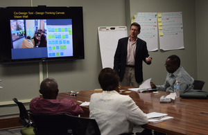 Wayne Beyea presenting to a group of UNIDO delegates from Nigeria during an MSU UN training.