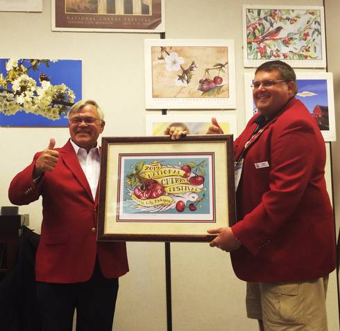Jim Flore, horticulture professor, receives the award from David Barr, president of the National Cherry Festival.