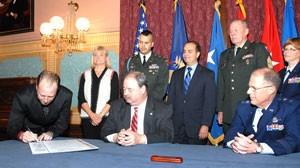 Adrian Blow signs the Michigan Military Family and Community Covenant on Nov. 12, 2008 at the state Capitol.
