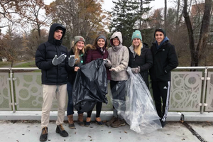 Pummell working to clean up campus with fellow students.