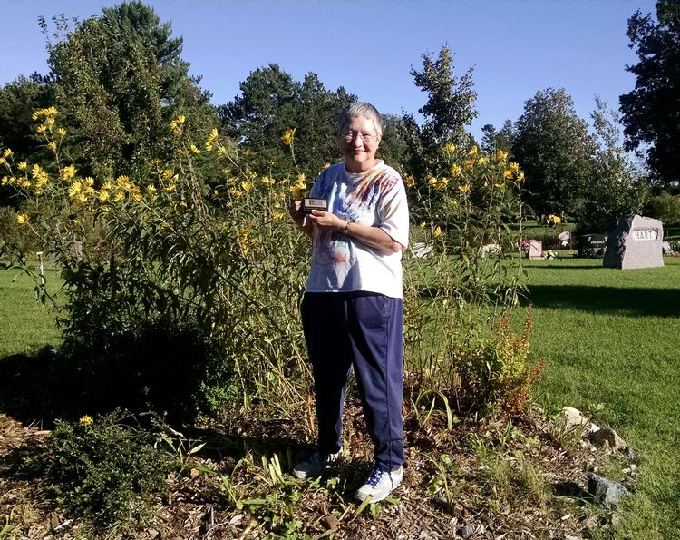 Jeannette Hauver with one of her many flower gardens at Park Cemetery. Photo: Rebecca Krans, MSU Extension
