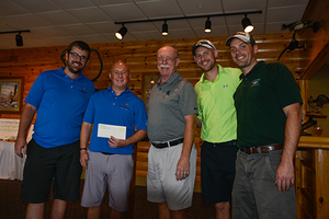 Image of the winning foursome, including Kevin Erickson, Craig Boss, Peter Crawford and Erik Cronk with Paul Nieratko.