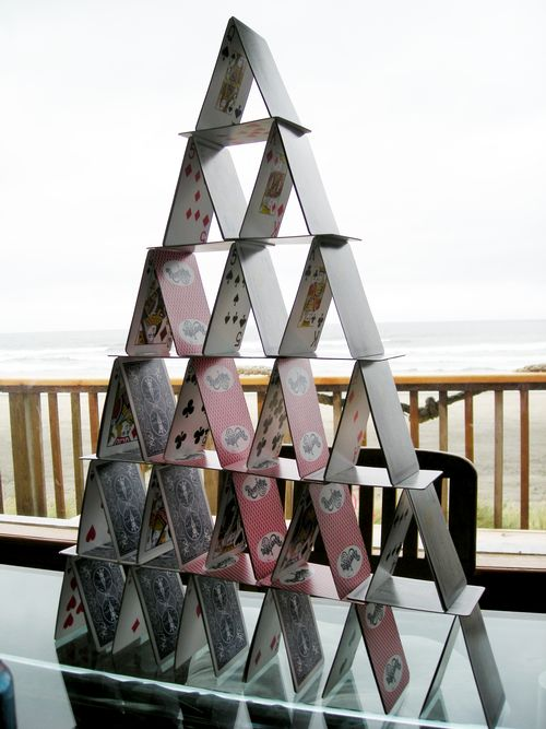 Try building a card castle shaped as a triangle. Photo by Wikimedia Commons
