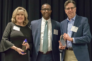 Brenda Reau and Tom Lyons of the MSU Product Center pose with Darryl Hunter from the Michigan Talent Investment Agency after receiving their awards.