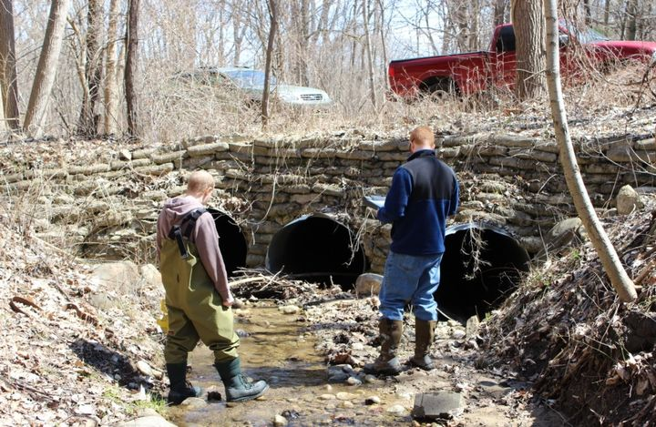 Volunteers assess a road stream crossing for multiple concerns including whether it is barrier to fish and other aquatic organism movement, is it causing erosion, and what condition the culvert in. Photo credit: Clinton River Watershed Council.