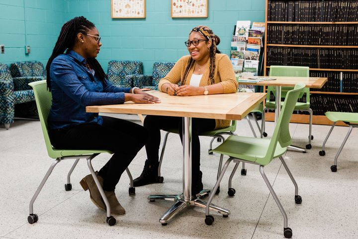 MSU Department of Forestry faculty member Asia Dowtin (left) talks with Sasha Bell, a graduate student in her second year at MSU. Bell previously studied at Medgar Evers College.
