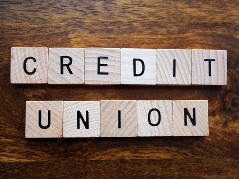 Credit union spelled out with Scrabble letters
