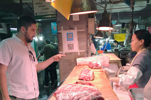 David Ortega at a pork market in China