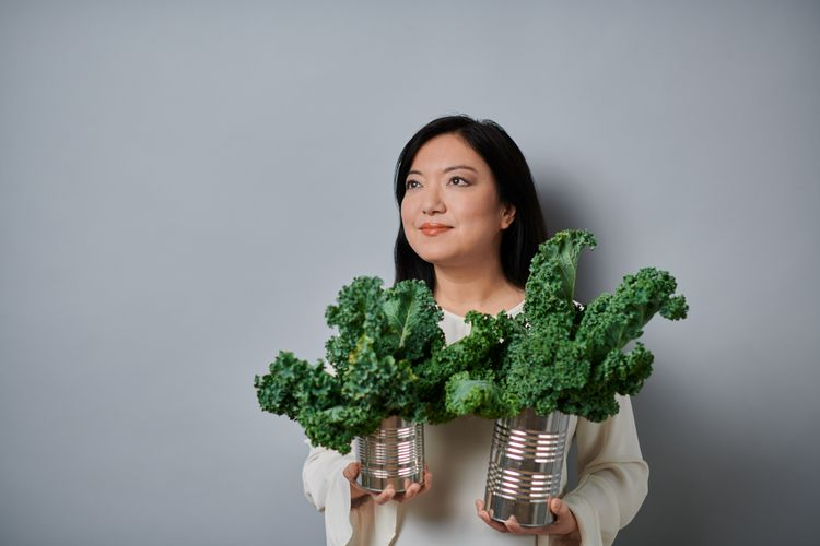 Felicia Wu holding a can of kale.