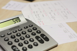 Calculating finances. Photo by Pixabay.