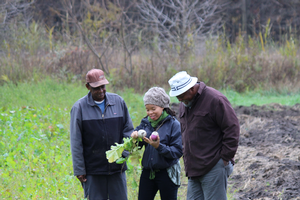 From left to right Isiah Tabb (fruit and vegetable producer),  Shakara Tyler (MSU Center for Regional Food Systems), Hakim Rashi