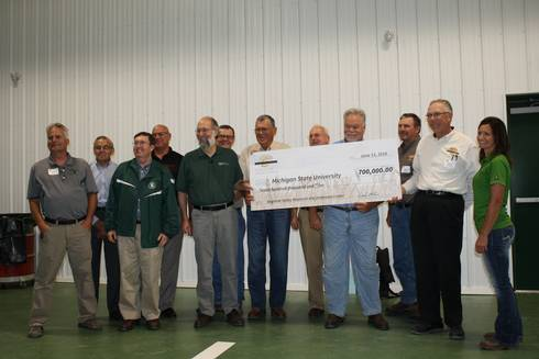 Representatives from MSU and the Michigan Wheat Program commemorate the contribution with a large check.