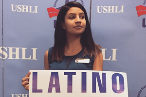 Alondra Alviso poses with a Latino Vote sign.